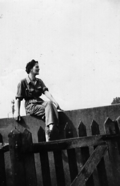 Woman Sitting On Wall Outside The Garden Gate 1941
