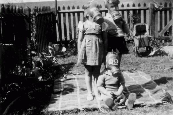 Children Wearing Gas Masks In Back Garden 1940
