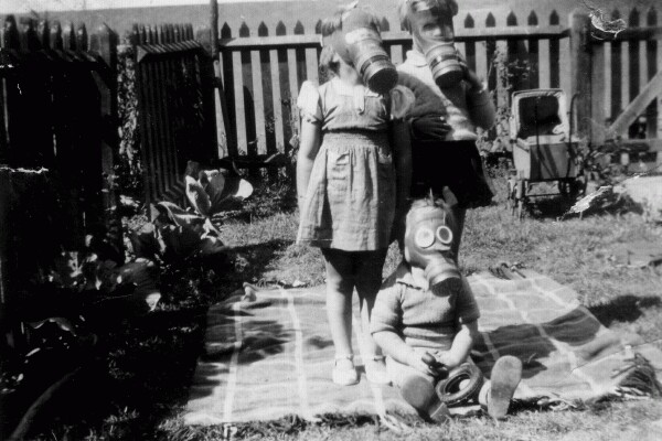 Children Wearing Gas Masks In Back Garden 1940