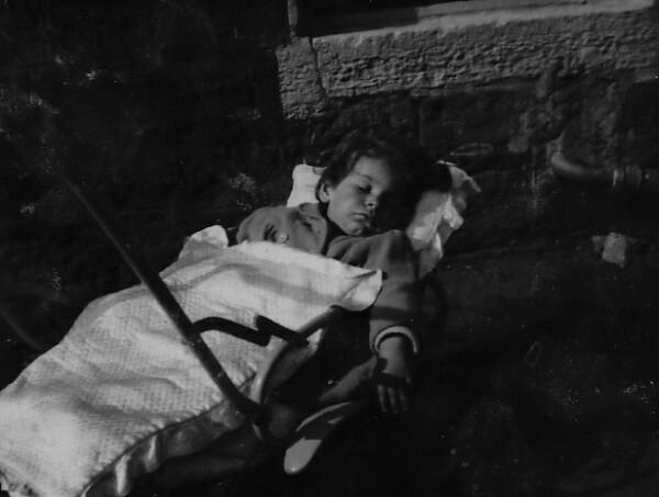 Child Asleep In Pram In Back Green At East Thomas Street c.1949