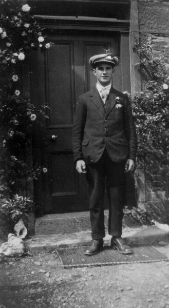 Young Man Standing In Front Of Doorway 1938