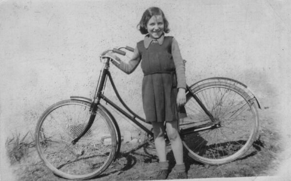 Girl Standing With Bicycle, 1st May 1941