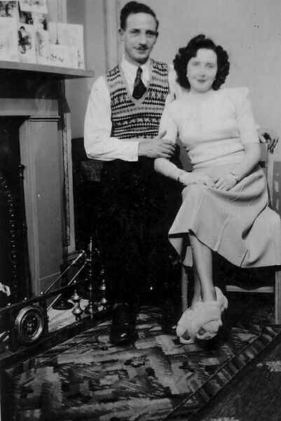 Couple Sitting By The Fire 1940s