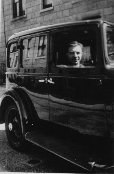 Man Sitting Behind Wheel Of Car 1930s