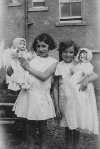 Two Girls With Their Dolls 1930