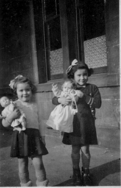 Two Young Sisters Standing Outside At Rossie Place With Their Dolls 1951