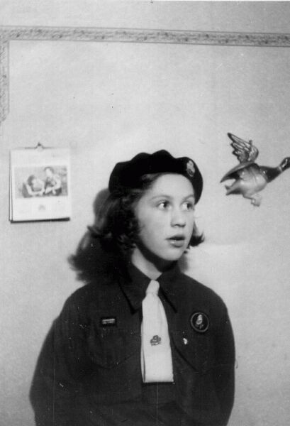 Girl Guide Standing Against Wall At Her Home 1955