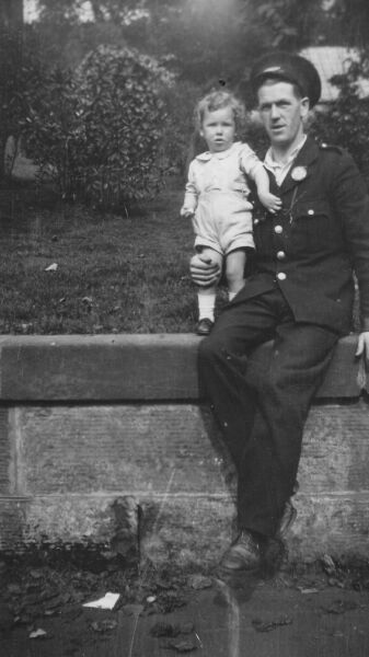 Busdriver Sitting On Wall With His Young Son 1939