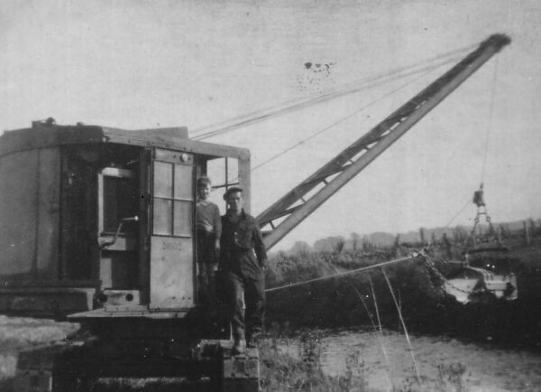 Excavator Operator Standing With His Son By The Cabin c.1946