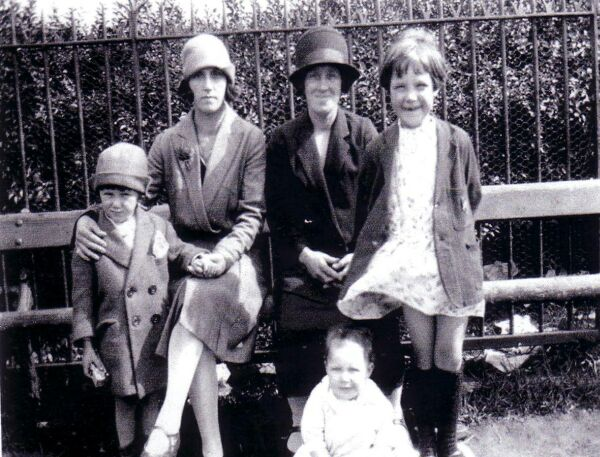 Two Sisters With Their Children Sitting On Bench In The Meadows, late 1920s