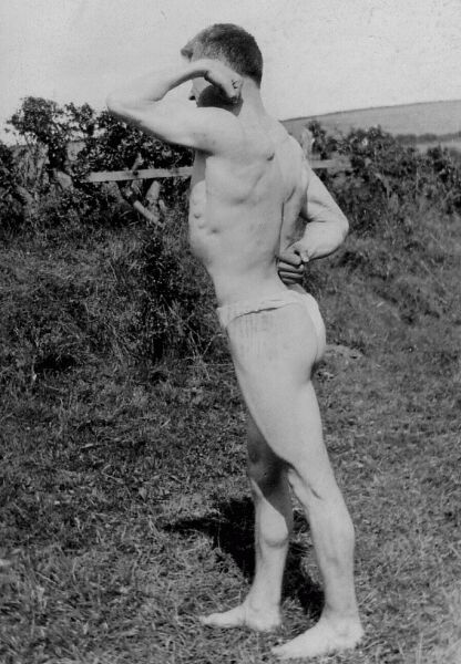 Bodybuilder Flexing His Muscles 1920s