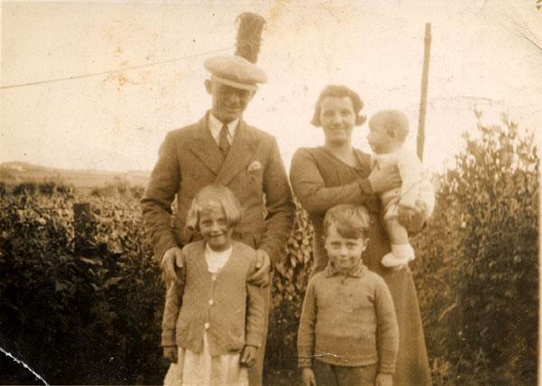 Family In Garden Standing In Front Of Hedge c.1936
