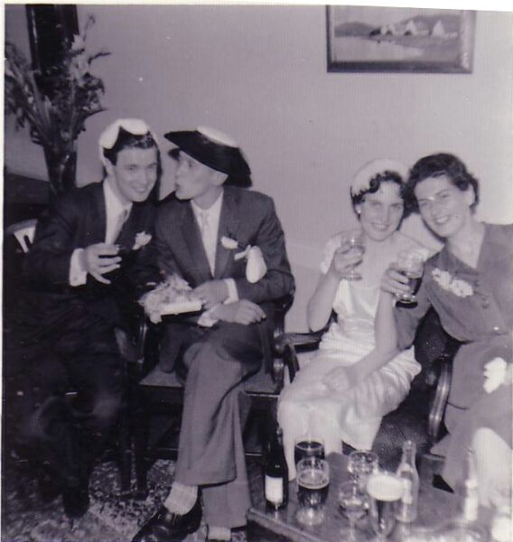 Two Couples Enjoying Party Drinks, late 1950s