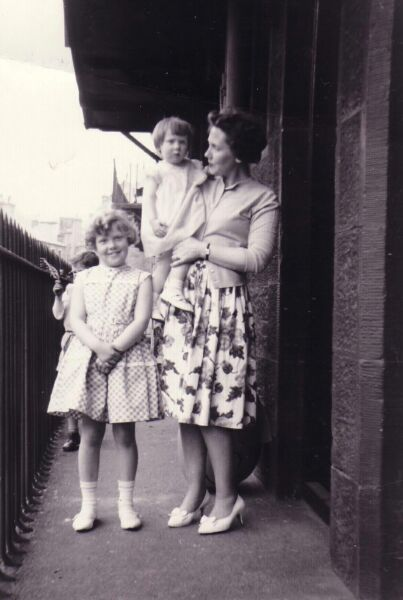 Young Family Standing On Balcony Close At 38 Prince Albert Buildings, Dumbiedykes 1962