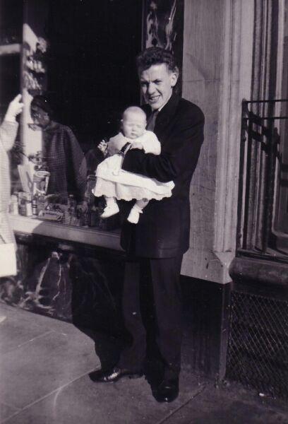 Man Holding Baby 1960