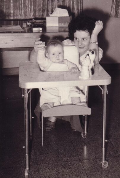 Mother With Her Baby Daughter At Feeding Table 1961