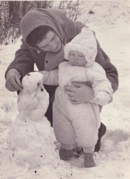 Mother And Daughter Building A Snowman 1961
