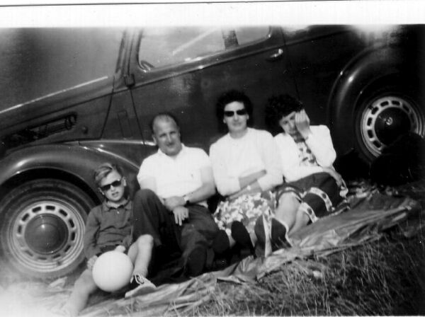Family Leaning Against Car Whilst Stopping On A Day Out 1961
