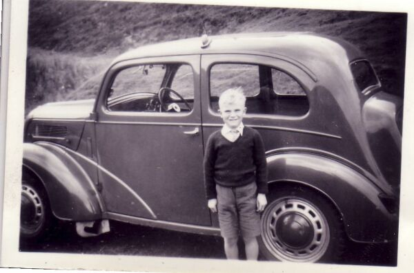 Boy Standing By His Family's First Car 1961