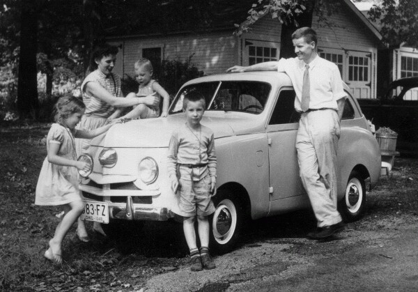Young Family Standing Around Their New Car, July 1948