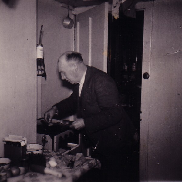 Man Cooking Up A Meal In The Kitchen 1950s
