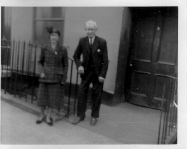 Elderly Couple Standing Outside The Stair Entrance To Their Flat In Saunders Street, Stockbridge c.1952