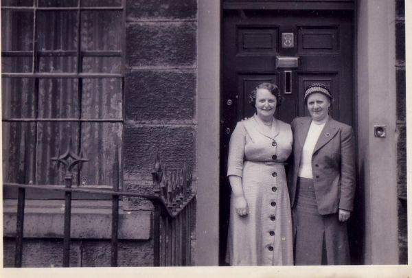 Two Women Standing In Tenement Doorway, early 1950s