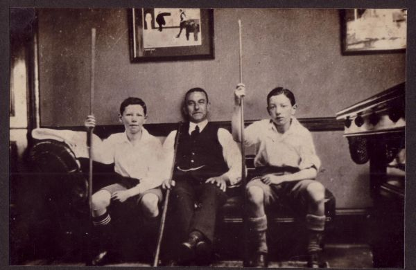 Father and sons ready to play billiards c.1923