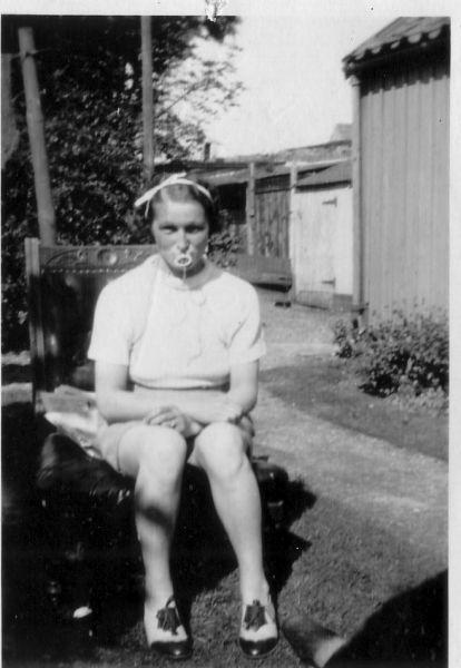 Woman Sitting In Garden Pretending To Be Baby c.1938