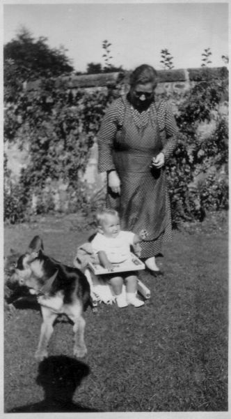 Grandmother And Grandson In The Back Garden With Dog 1938