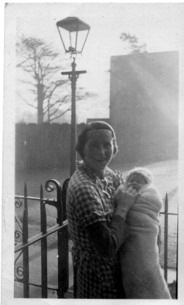 Mother With Baby By Gas Lamp Ouside Home At 27 Restalrig Gardens, January 1937
