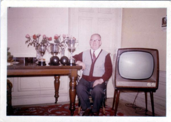 Bowler Sitting By Television With His Trophies At Home In  8 Salisbury Street, early 1960s