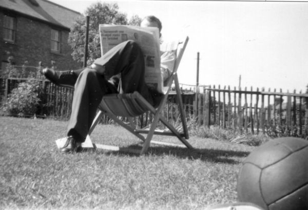 Reading The Newspaper In The Back Garden At 39 Northfield Crescent c.1957