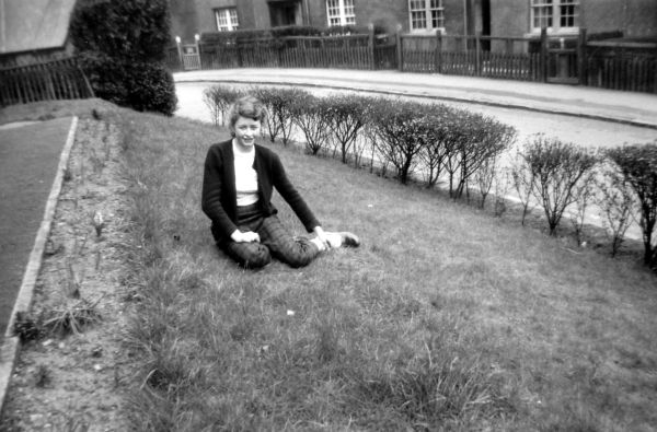 Young Woman Sitting On Garden Lawn At 39 Northfield Crescent c.1958