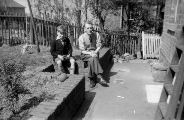 Man And Boy Sitting In The Back Garden At 39 Northfield Crescent c.1957