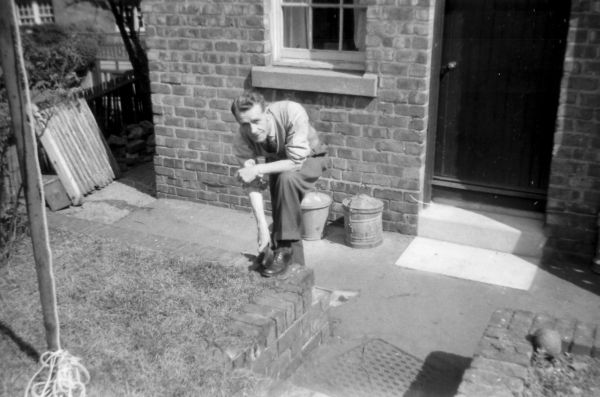 Man Polishing His Shoes In His Back Garden At 39 Northfield Crescent c.1957