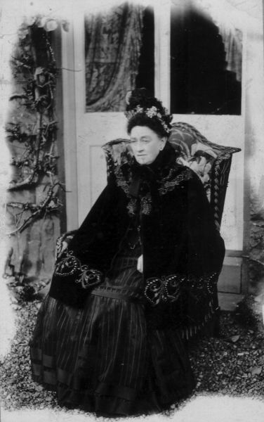 Victorian Lady Seated In Chair By Doorway c.1900