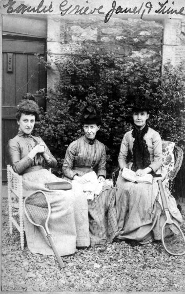 Three Women Seated In Garden With Tennis Racquets c.1900