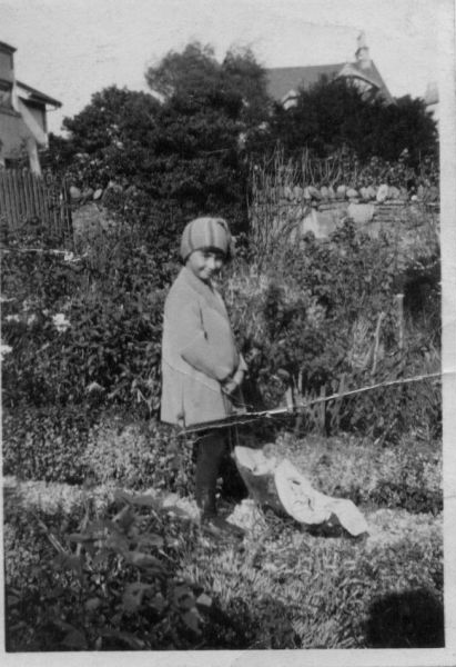 Girl Playing In Garden With Toy Pushchair c.1925