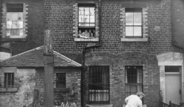 Four Women At Window Look On As Fifth Woman Works In Garden c.1955