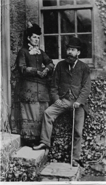 Victorian Lady And Gentleman Standing On Doorstep 1878