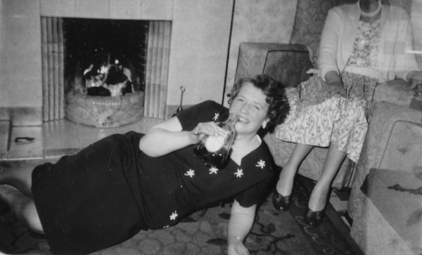 Woman Having A Christmas Drink On The Sitting Room Carpet 1957