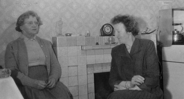 Two Women Round The Fireplace c.1950