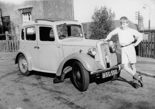 Boy Leaning On Vintage Car 1960
