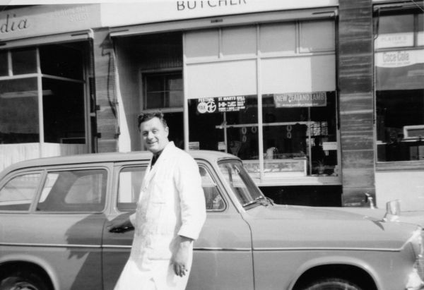 Butcher By Car Outside His Shop c.1963