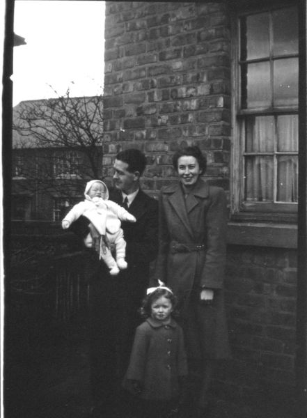 Young Family Outside Their Home c.1945