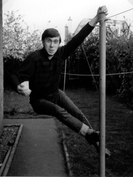 Young Man Swinging Off A Clothes Post, July 1968