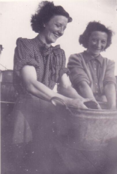 Two Sisters Hand-Washing Clothes At Caravan Site 1947