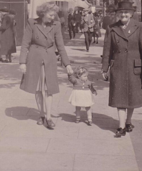 Grandmother, Mother, And Daughter Walking Along Street 1948