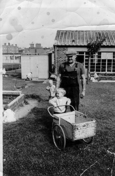 Young Boy At Nursery With Wheelbarrow Made By His Grandfather, July 1965
